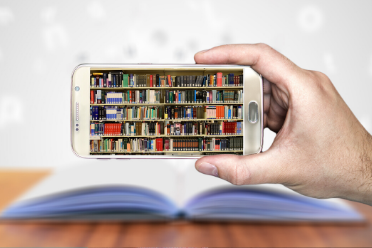 cell phone with an image of a library shelf and books