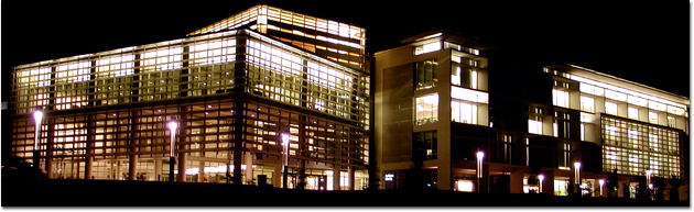 Photo of the exterior of the UC Merced Library lit up at night.