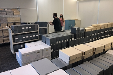 Library staff moving collections into the building