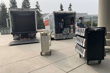 Library staff unloading collections on campus