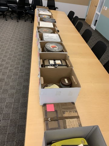 Boxes of film reels from the University of California Division of Agriculture and Natural Resources, UC Cooperative Extension Records.